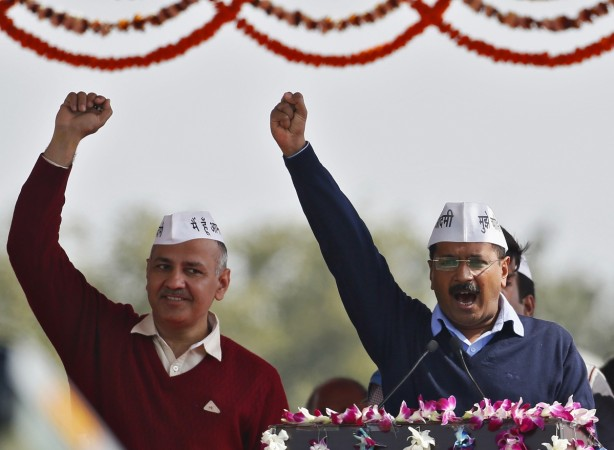 Arvind Kejriwal (R), chief of Aam Aadmi (Common Man) Party (AAP),