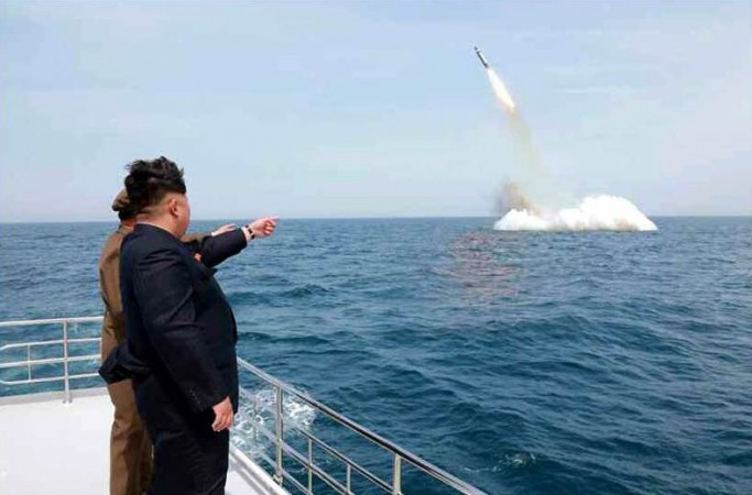 German experts claim that the images released by North Korea of the country successfully testing a submarine launched missile is found to have been photoshopped.