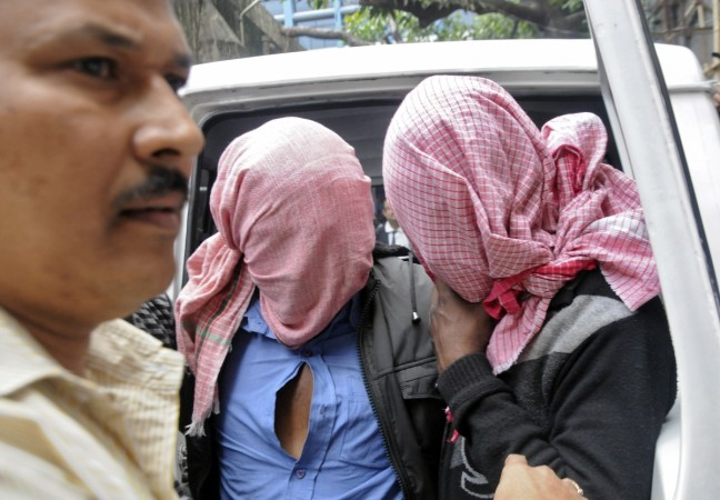 Accused being taken by police