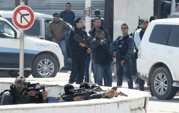 Isis militants reportedly were believed to behind the attack on two beach resort hotel on Friday in Tunisia. File Image shows men from country's counter-terrorist taking position during the terror attack at Bardo Museum in March.