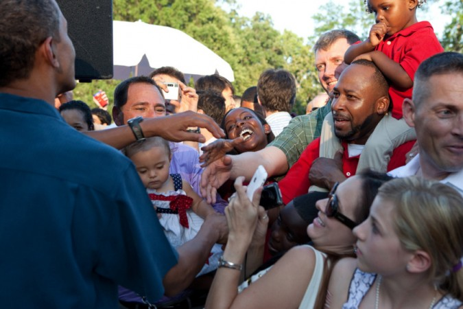 President Obama greets guests during the Fourth of July celebration on the South Lawn of the White House, July 4, 2010