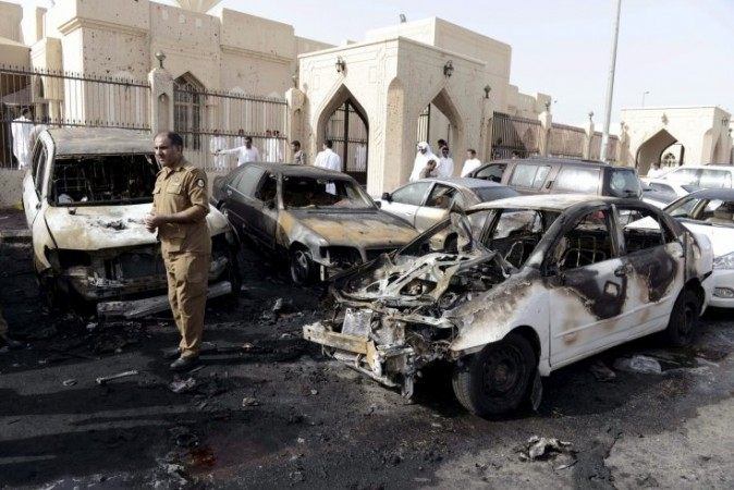 A policeman inspects the site of a car bomb near the Shi'ite al-Anoud mosque in Saudi Arabian city Dammam