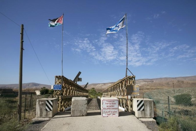 Israel will build a 30 km fence along its border with Jordan to seal-off the country from any attacks by Isis. File image shows Israeli and Jordanian flag on a border between the two countries.