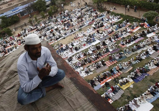 Muslims offer last Friday prayers at the Jama Masjid (Grand Mosque) ahead of Eid-al-Fitr in the old quarters of Delhi August 17, 2012.