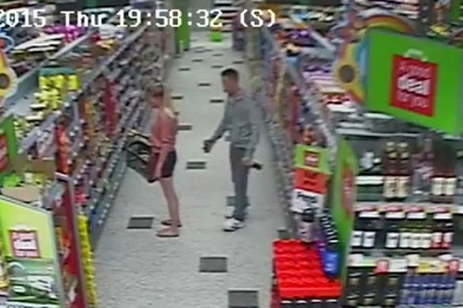 man trying to take photos of a woman's bums caught on camera.