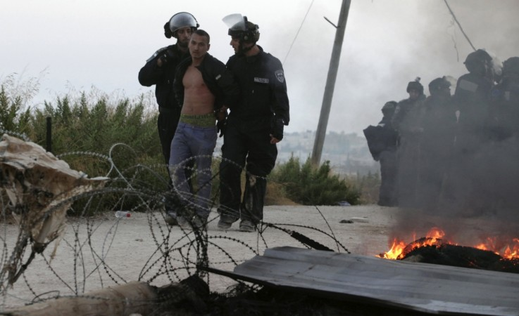 Israeli forces and settlers clash during evacuation of West Bank buildings