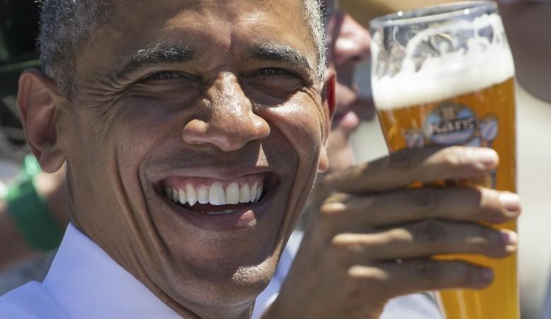U.S. President Barack Obama toasts with beer as he visits Kruen, southern Germany.