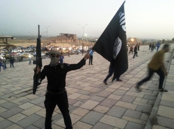 isis militant waves flag