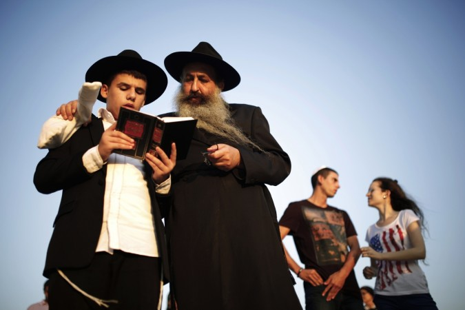 Orthodox Jews take part in the Tashlich prayer, a Rosh Hashanah ritual.