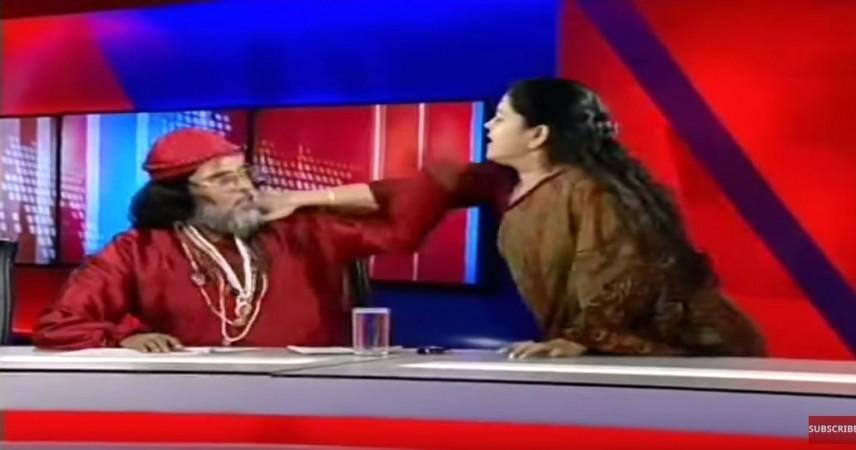woman slaps godman on live TV