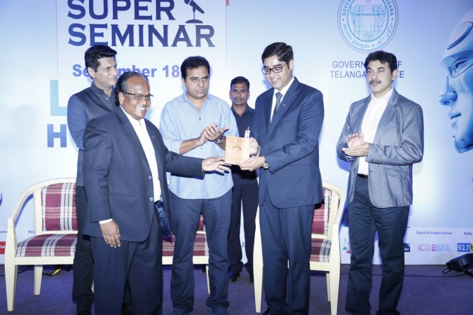 KTR presenting the momento of India Gadget Expo