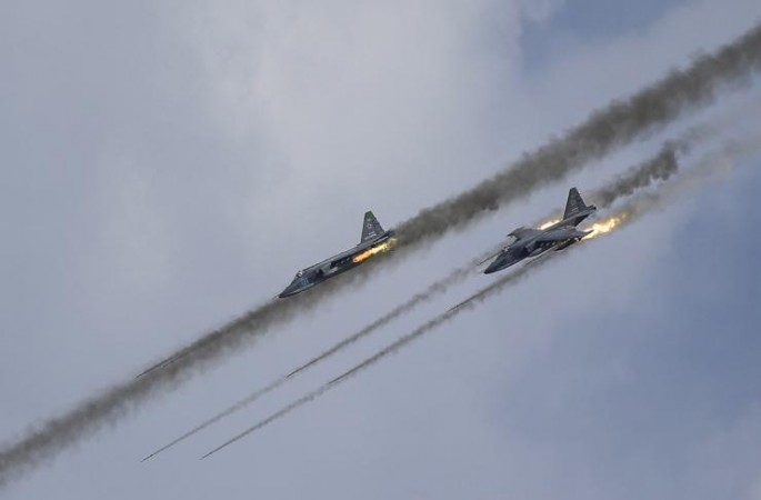 In this photo, Russian Sukhoi Su-25 Frogfoot ground-attack planes perform during the Aviadarts military aviation competition at the Dubrovichi range near Ryazan, Russia, on Aug. 2, 2015.