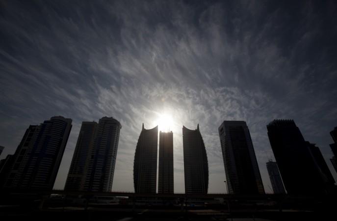 The sun rises above Jumeirah Lakes towers in Dubai