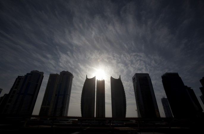 The sun rises above Jumeirah Lakes towers in Dubai