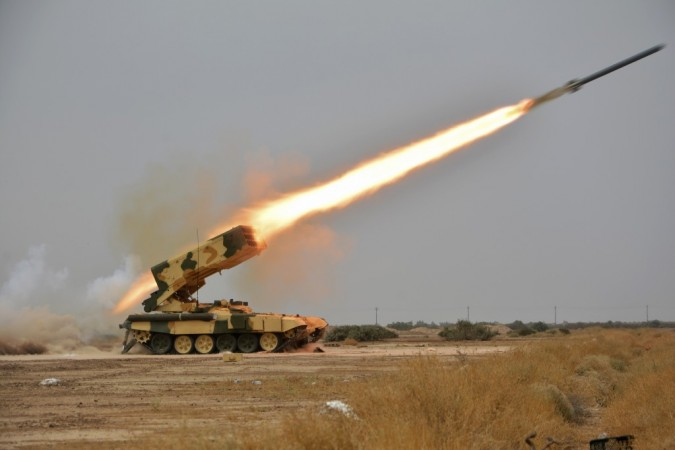 A Russian-made multiple rocket launcher known as the TOS-1A fires during training at a military camp in Baghdad, October 14, 2014.