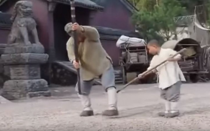 Jackie Chan learning Shaolin techniques from a young master