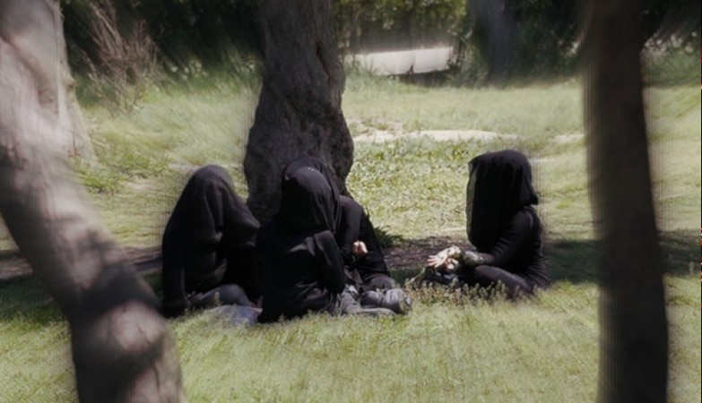 Veiled women sit as they chat in a garden in the northern province of Raqqa, March 31, 2014.