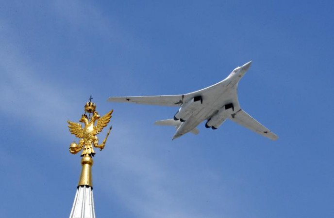 A Tu-160 heavy strategic bomber flies during the Victory Day parade above Red Square in Moscow, Russia, May 9, 2015.