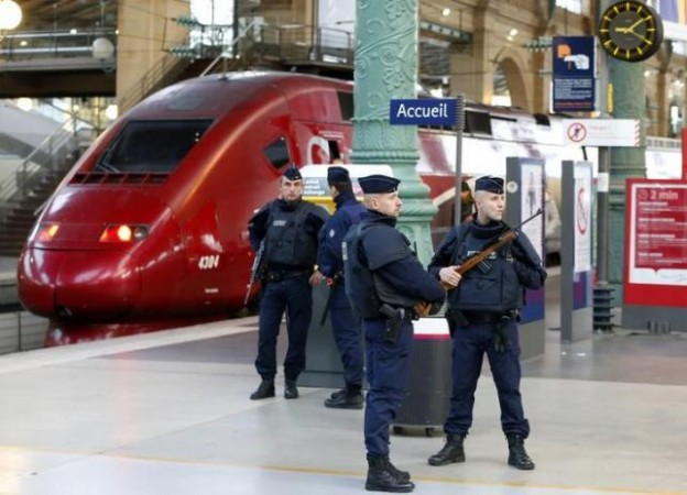 Police patrol the Gare du Nord train station near a high-speed international Thalys train the morning after a series of deadly attacks in Paris , November 14, 2015.