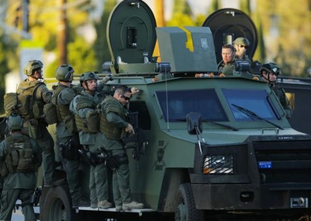 Police officers conduct a manhunt after a mass shooting in San Bernardino, California December 2