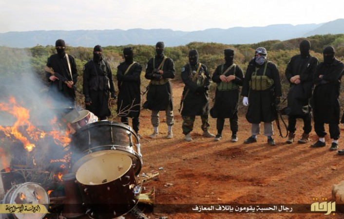 Isis in Libya burning musical instruments.