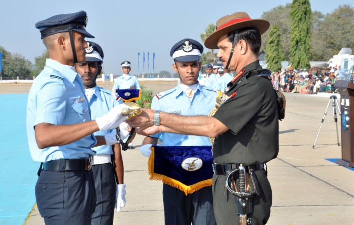 Chief of Army Staff General Dalbir Singh presents the prestigious Chief of the Air Staff (CAS) Sword of Honour to Flying Officer Lavpreet Sharma who stood first in overall merit in 196 Pilot Course, at the Combined Graduation Parade, at Air Force Academy,