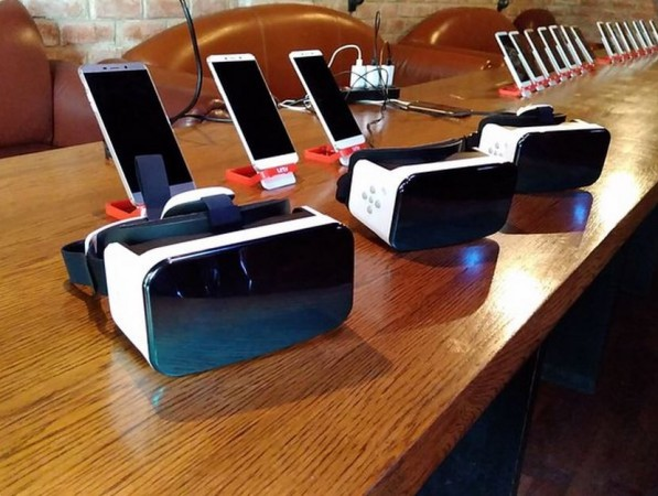 LeEco phones and 3D VR sets displayed at an event in India