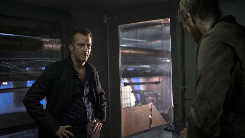 Miller and Holden are locked in Eros' space station
