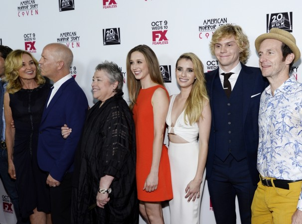 Emma Roberts and Evan Peters with the cast of