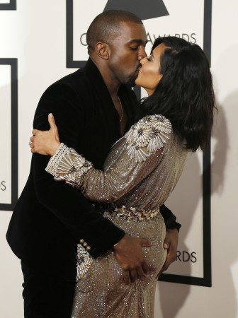 Kim Kardashian and Kanye West kissing and hugging each other at the 57th annual Grammy Awards in Los Angeles.