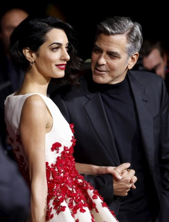 George Clooney looks lovingly at his beautiful wife Amal Alamuddin at the premiere of
