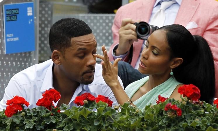 Jada Pinkett Smith making sure her husband is photo-ready.