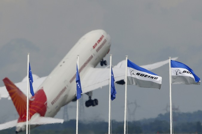 air india mishap atc 2 pilots suspended after plane hits