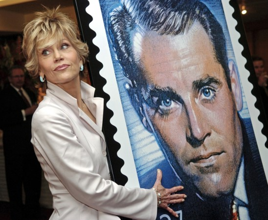 Jane Fonda with a design of the US commemorative postage stamp featuring father Henry Fonda