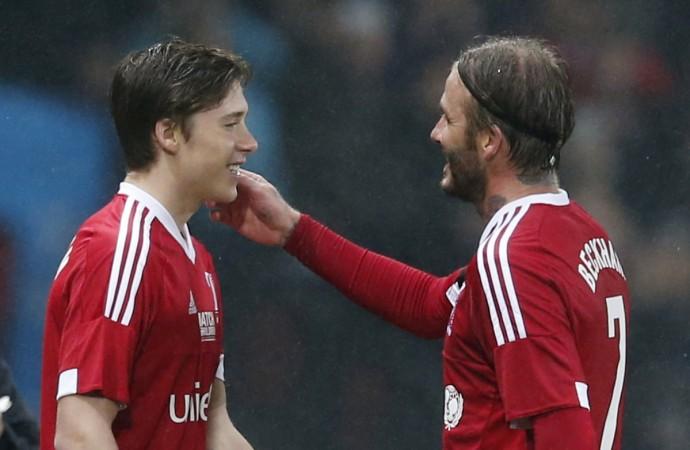 Brooklyn and David Beckham during the  Great Britain & Ireland XI v World XI - Unicef Charity Match.