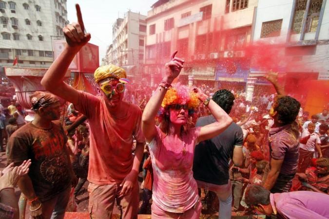 Foreign tourists celebrate Holi