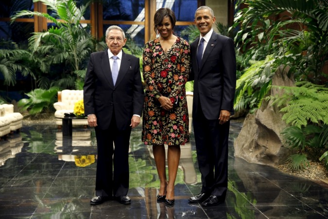 Cuban President Raul Castro greets U.S. President Barack Obama and first lady Michelle Obama