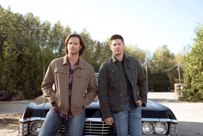 Sam and Dean in front of the Impala
