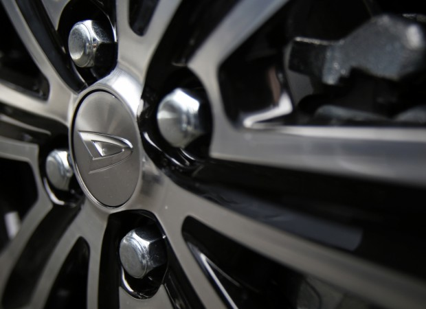 A logo of Daihatsu Motor Co. is seen on a wheel of its TanTo CUSTOM at the company's dealership in Tokyo