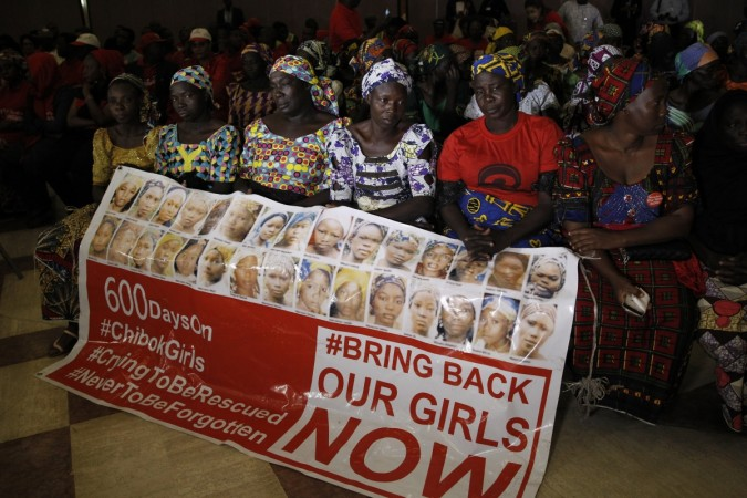 Nigeria leader meets Chibok girls, leaves for medical trip amid health fears