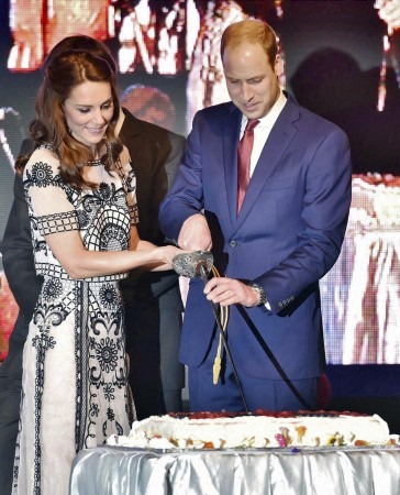 Kate Middleton and Prince William cut the cake to celebrate Queen Elizabeth's 90th birthday.