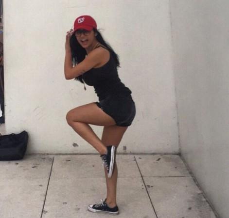 Mia Khalifa pretending to pitch