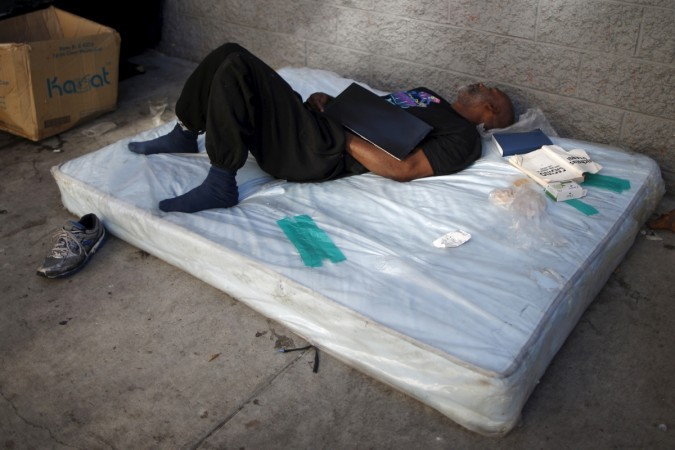 A man sleeps on a matress on Skid Row in downtown Los Angeles