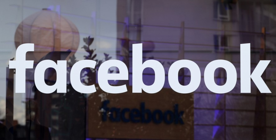 The logo of Facebook is pictured on a window at new Facebook Innovation Hub