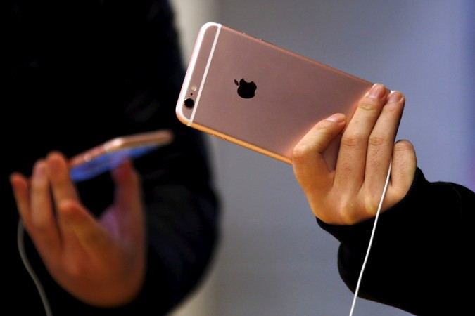 Customers hold the iPhone 6s during the official launch at the Apple store in central Sydney