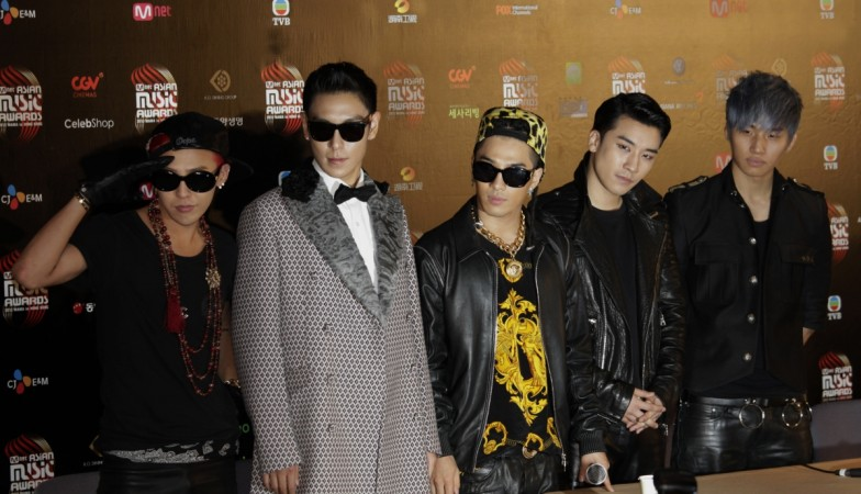 Members from South Korean pop group Big Bang pose backstage after winning Artist of the Year Award in the 2012 Mnet Asian Music Awards