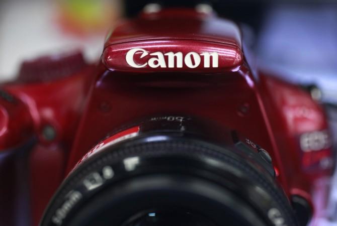 Canon's first quarter operating profits tumble 39 percent; lowers FY estimates