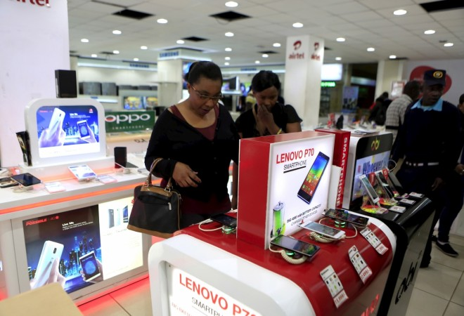 People look at smartphones of Chinese brand Lenovo