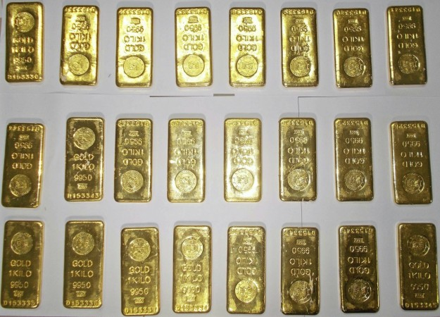 gold bars gold smuggling gold prices india spicejet seat concealed india duty import loss government govt