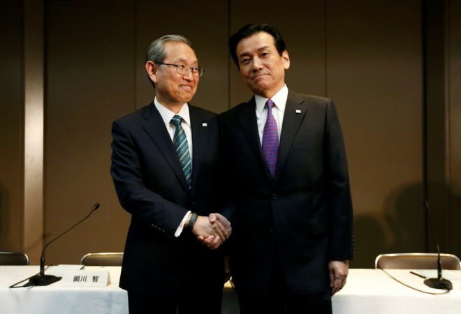 Toshiba Corp incoming President and chief executive Satoshi Tsunakawa (L) and incoming chairman Shigenori Shiga during a news conference at the company headquarters in Tokyo, Japan